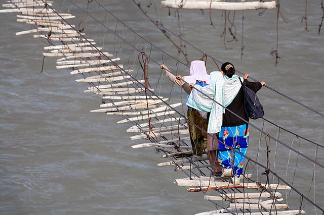 Hussnaini Bridge is the world's most dangerous suspension bridge. With rotten pieces of ropes and weak wooden planks, Hussaini Bridge is hanging over River Hunza for years and people walk over it everyday.