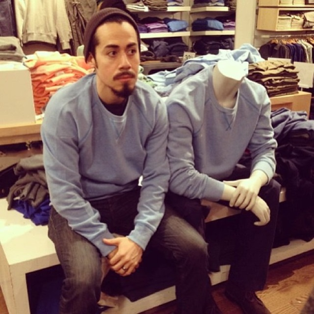 guy takes pictures with dummies