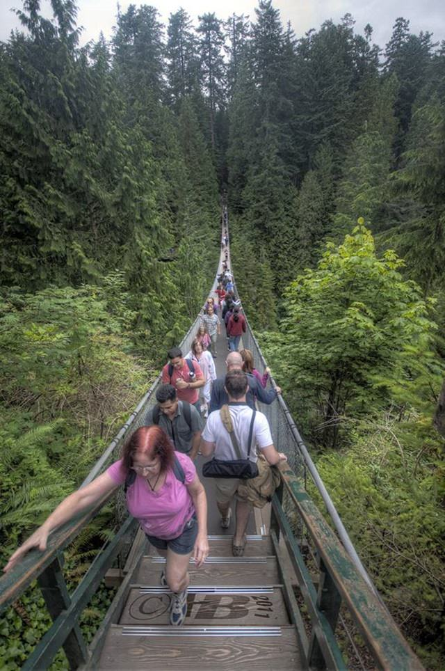 Capilano Bridge constructed in 1889 suspends over the deep woods of Vancouver. It has height of 70 meters and a length of 337 meters.