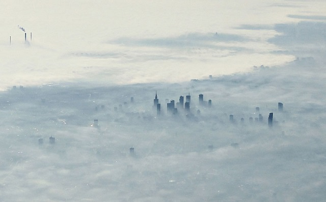 6_warsaw-poland-covered-in-fog-from-an-airplane-aerifal-from-above
